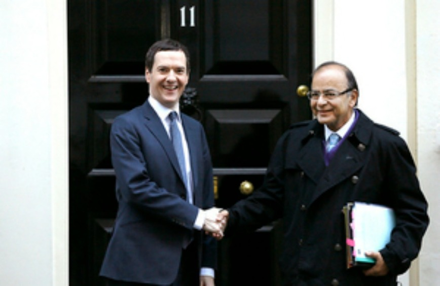 Britain's Chancellor George Osborne, left, welcomes the Indian Finance Minister Arun Jaitley to Downing Street for the 8th Uk-India Economic and Financial Dialogue, in London, Tuesday, Jan. 19, 2016. (AP Photo/Kirsty Wigglesworth)